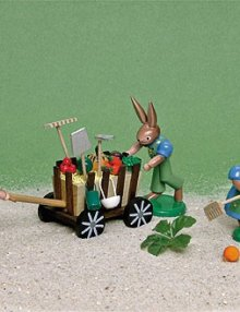 Hasenfamilie mit Erntewagen