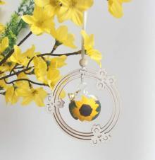 Behang Glaskugel Sonnenblume im Blumenkranz