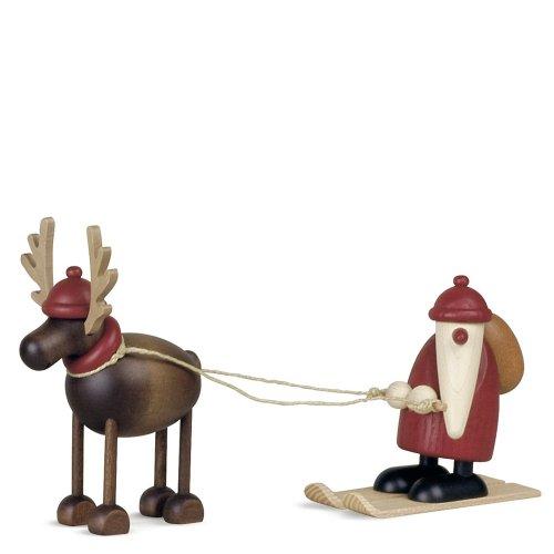 Rentier Rudolf mit Weihnachtsmann auf Ski